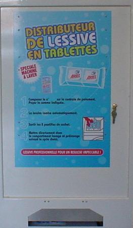 Distributeur de lessive pour laverie